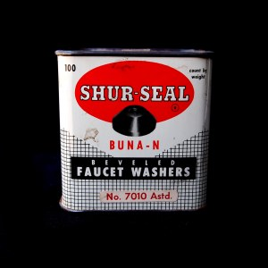Shur-Seal tin from front, on black background.