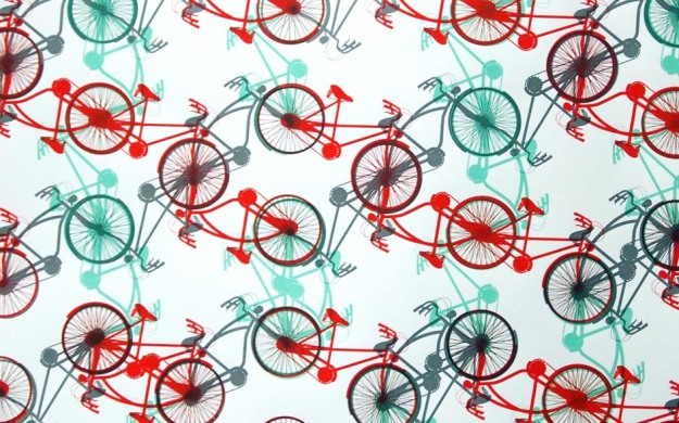 A portion of the first colorway (mint green, coral red/orange, shimmery grey) happify poster for the 2015 Minneapolis Artcrank poster party, with a quasi-repeating pattern of bicycles screen-printed in three different colors on 100% post-consumer recycled Mohawk paper