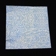 Close-up of (City of Minneapolis) security envelope with blue dense linework pattern evoking organic street map on white paper used for happify origami cranes.