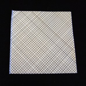 Close-up of security envelope with black loose grid pattern on white paper used for happify origami cranes.